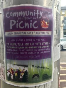 Community Picnic flyer on electric pole in Kilburn