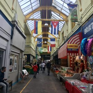 A variety of national flags hang from the roof of the Brixton Village Market